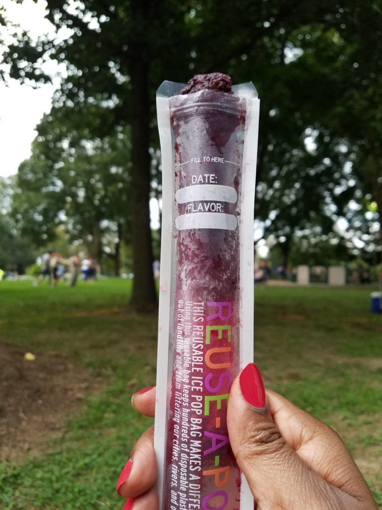 A delicious alcoholic popsicle at the park. No one is the wiser